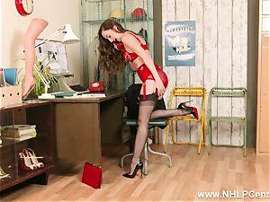 brunette on phone in retro underwear nylon high heels