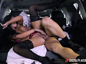 Romi Rain drilled in the back of the car