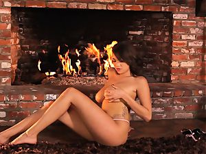 Cassidy Banks playthings her honeypot by the fireside